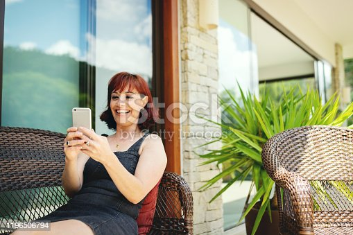 825083304 istock photo Portrait of a beautiful woman using cell phone 1196506794