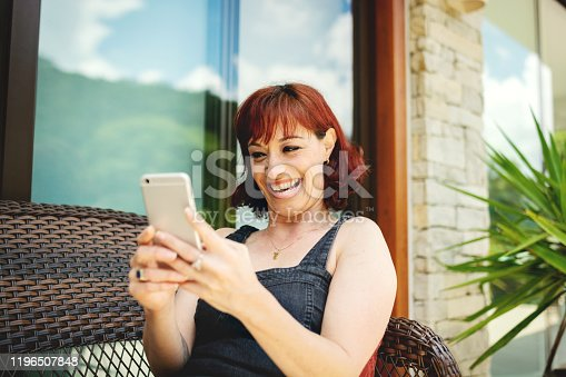 825083304 istock photo Portrait of a beautiful woman using cell phone 1196507848