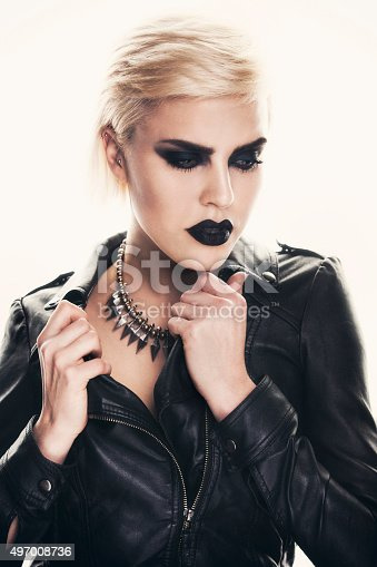 istock Portrait of a beautiful woman with a strong dark makeup. 497008736