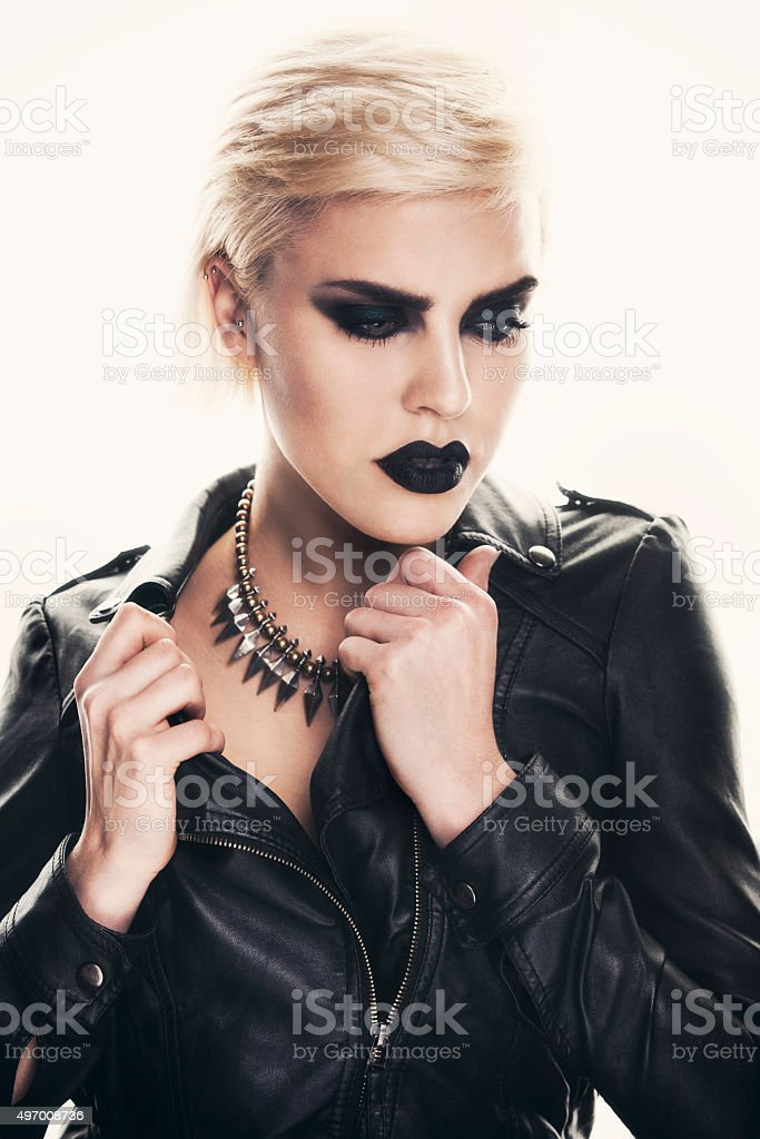 Portrait of a beautiful woman with a strong dark makeup. stock photo
