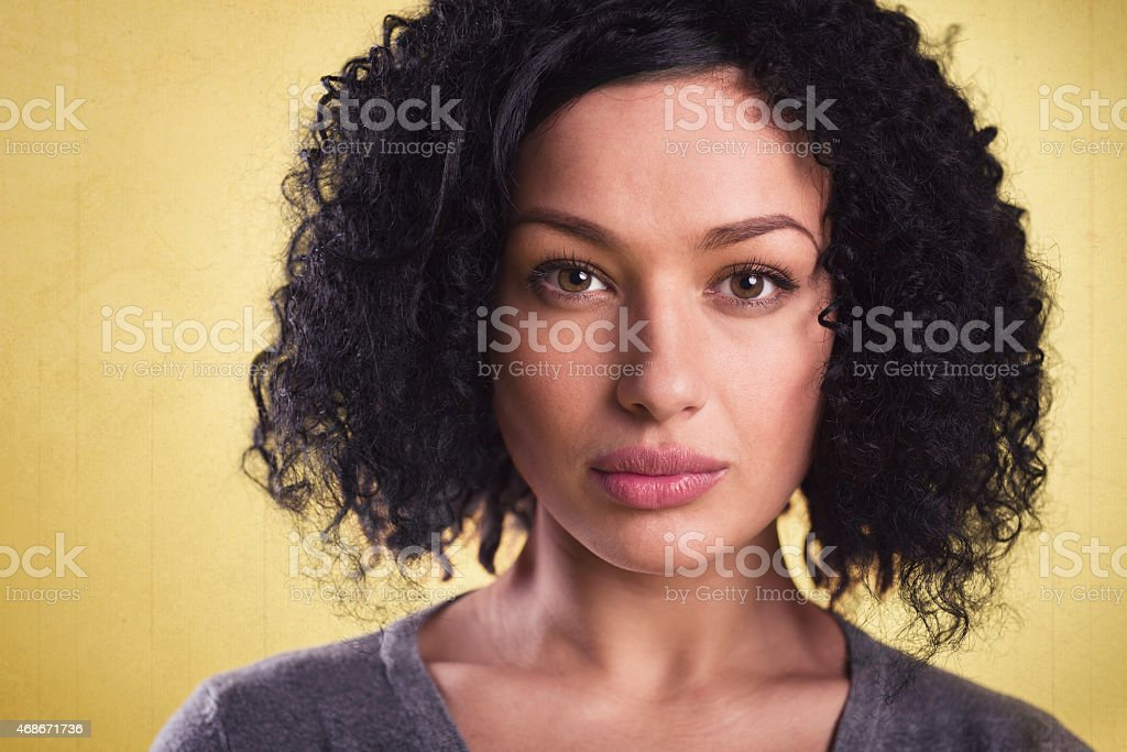 Portrait of a beautiful woman with afro hair. stock photo