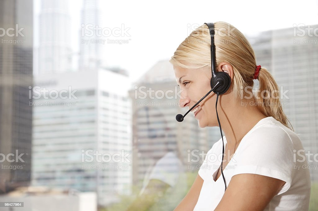 Portrait of a beautiful  woman with headset royalty-free stock photo