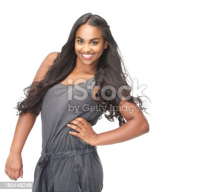629077968istockphoto Portrait of a beautiful woman with long hair smiling 180448248