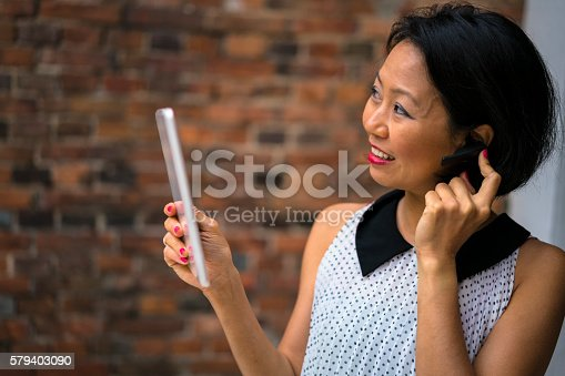 519052198 istock photo Portrait of a beautiful woman with tablet in Kyoto, Japan. 579403090