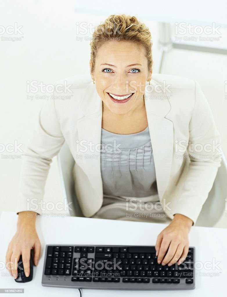 Portrait of a beautiful woman working on computer in office royalty-free stock photo