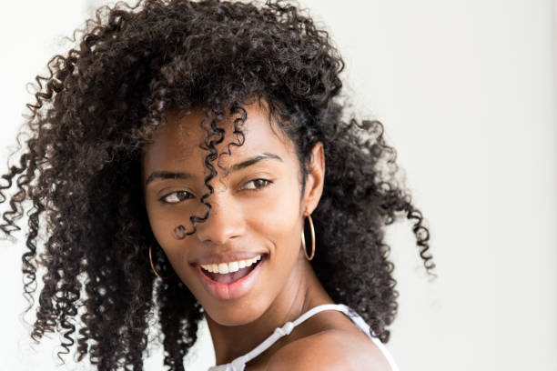 """Portrait of a beautiful young black woman looking into camera """"n Portrait of a beautiful young black woman looking into camera """"n curly hair stock pictures, royalty-free photos & images"""
