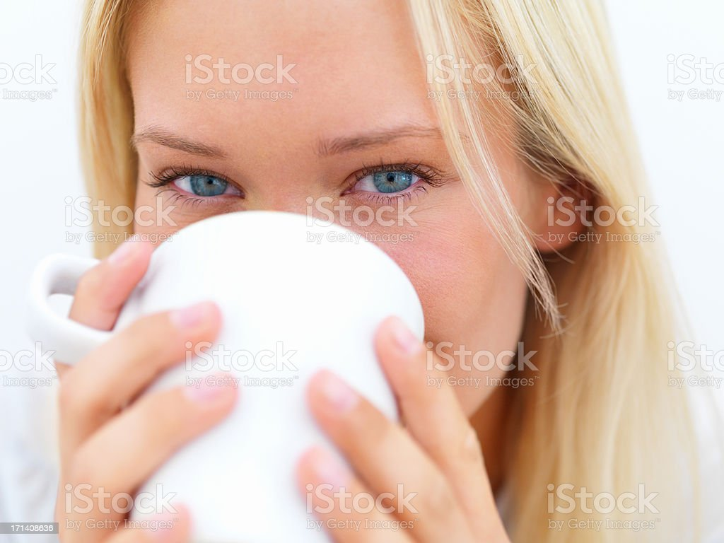 Portrait of a beautiful young girl drinking coffee royalty-free stock photo