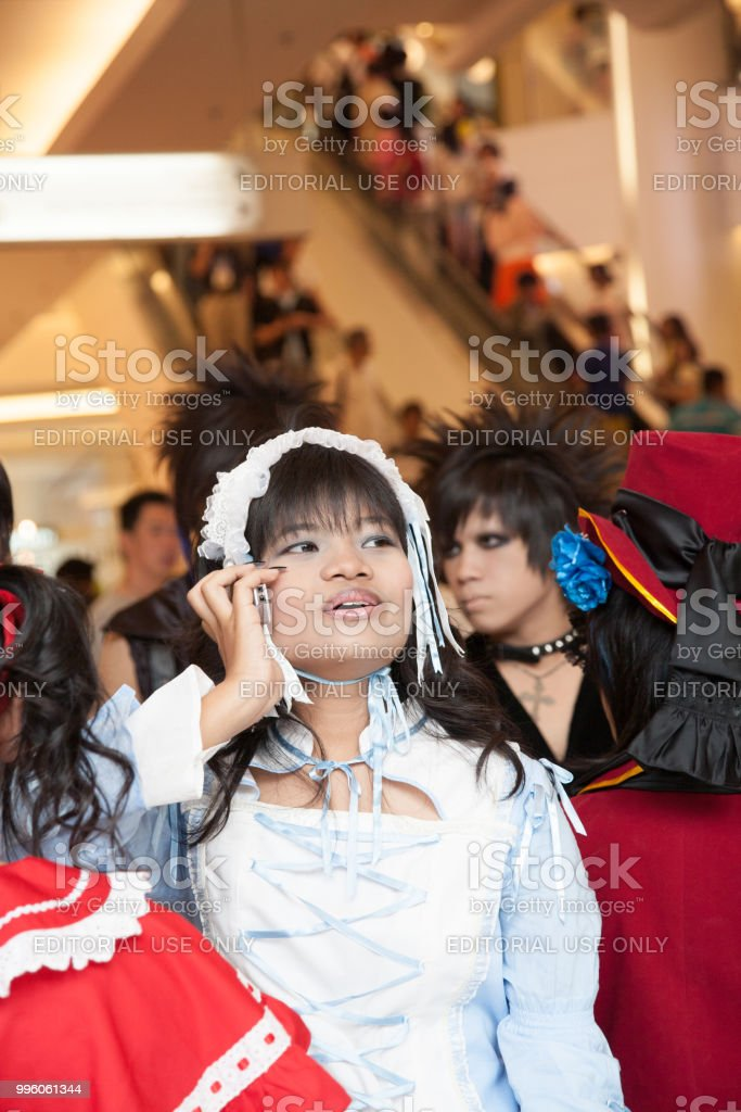 dfa91540a503 Portrait of a beautiful young girl during a cosplay festival in front of  Siam Pagagon