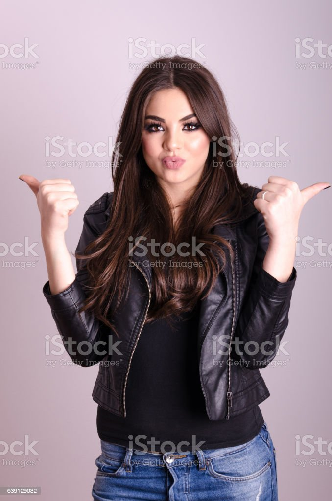 Portrait of a beautiful young girl showing ok sign stock photo