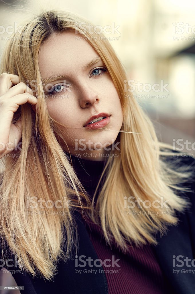 Portrait of a beautiful young girl with freckles stock photo