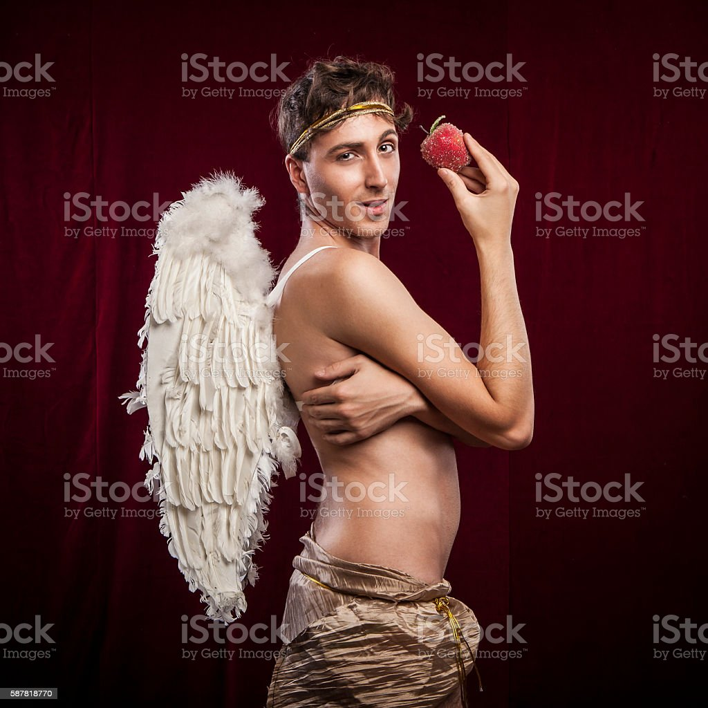 portrait of a beautiful young man with angel's wings stock photo
