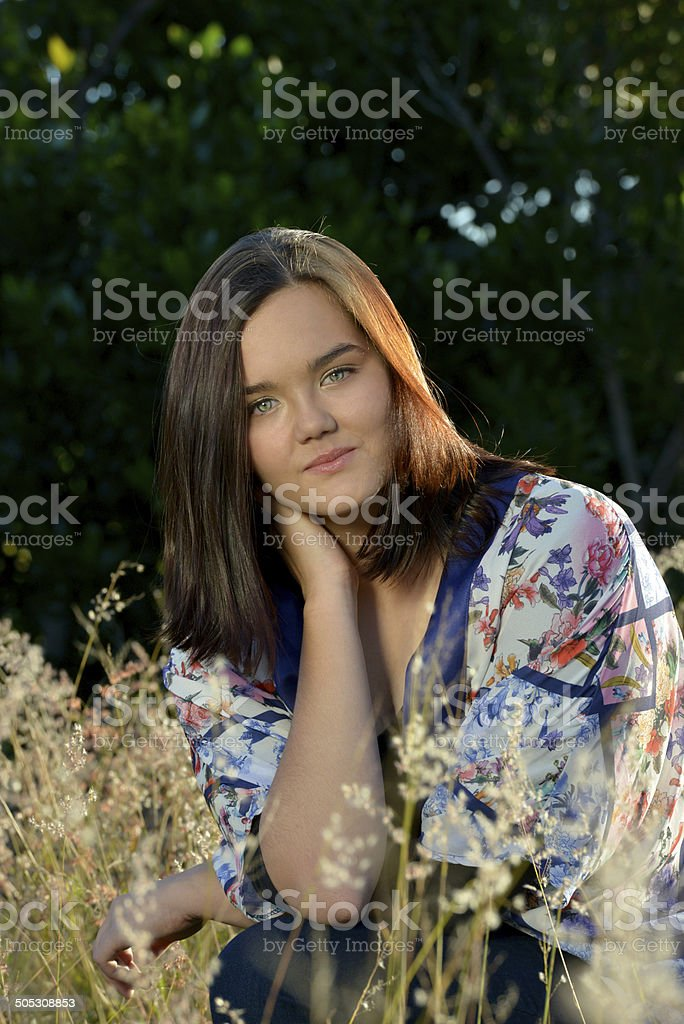 Portrait of a beautiful young woman - blurred background royalty-free stock photo
