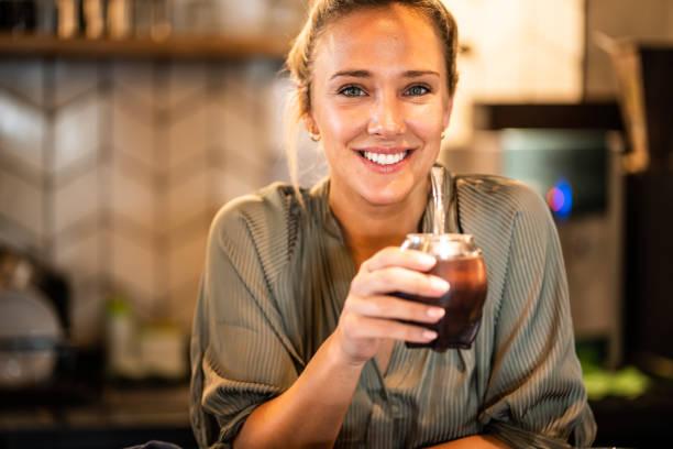Portrait of a beautiful young woman enjoying yerba mate stock photo