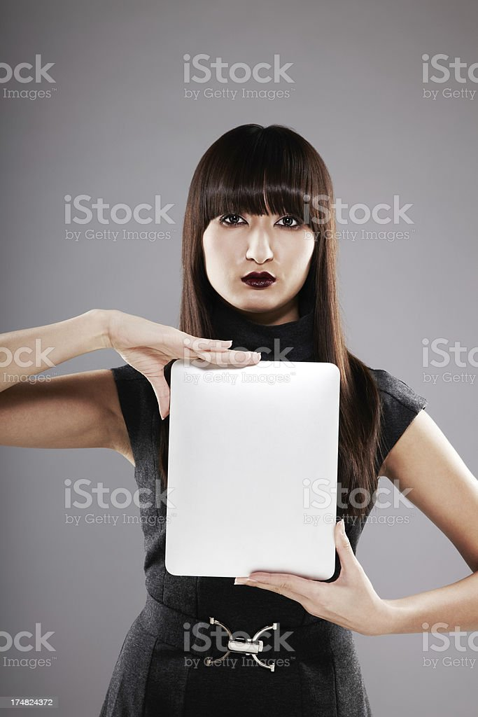 Portrait of a beautiful young woman holding digital tablet royalty-free stock photo