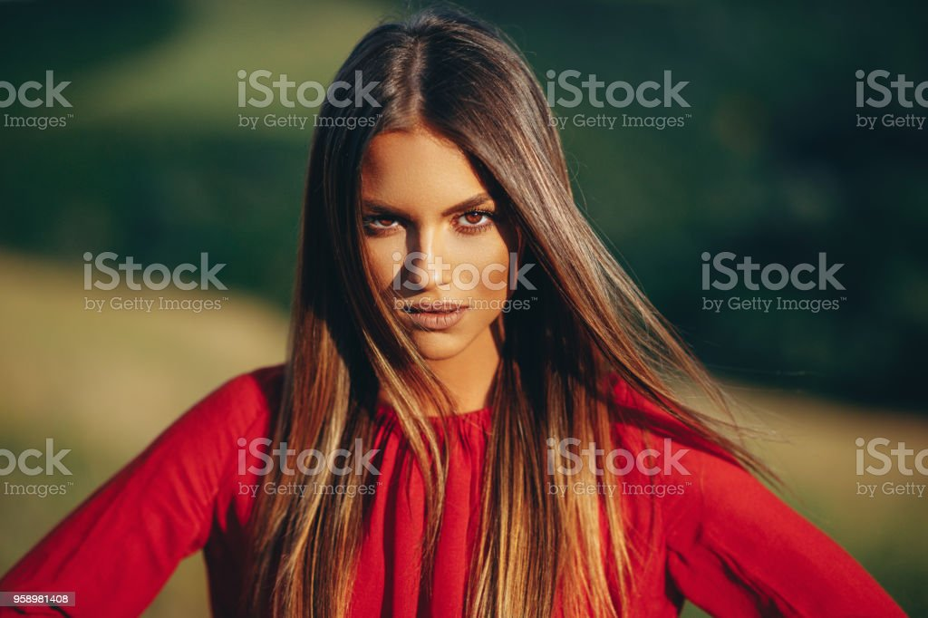 Portrait of a beautiful young woman in nature stock photo