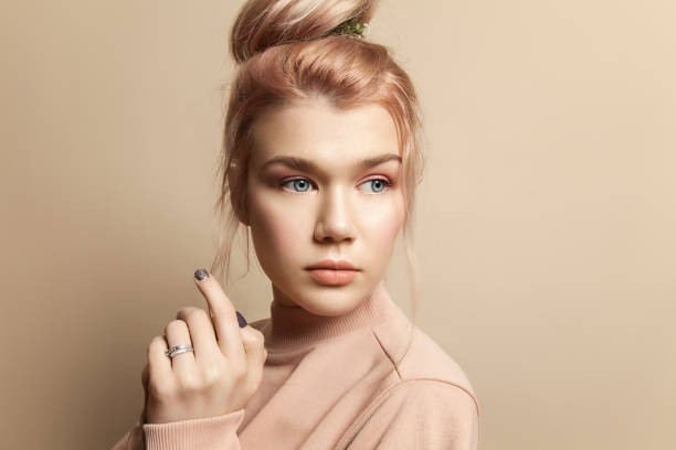 Cтоковое фото Portrait of a beautiful young woman in soft powdery beige pastel colors with natural make-up