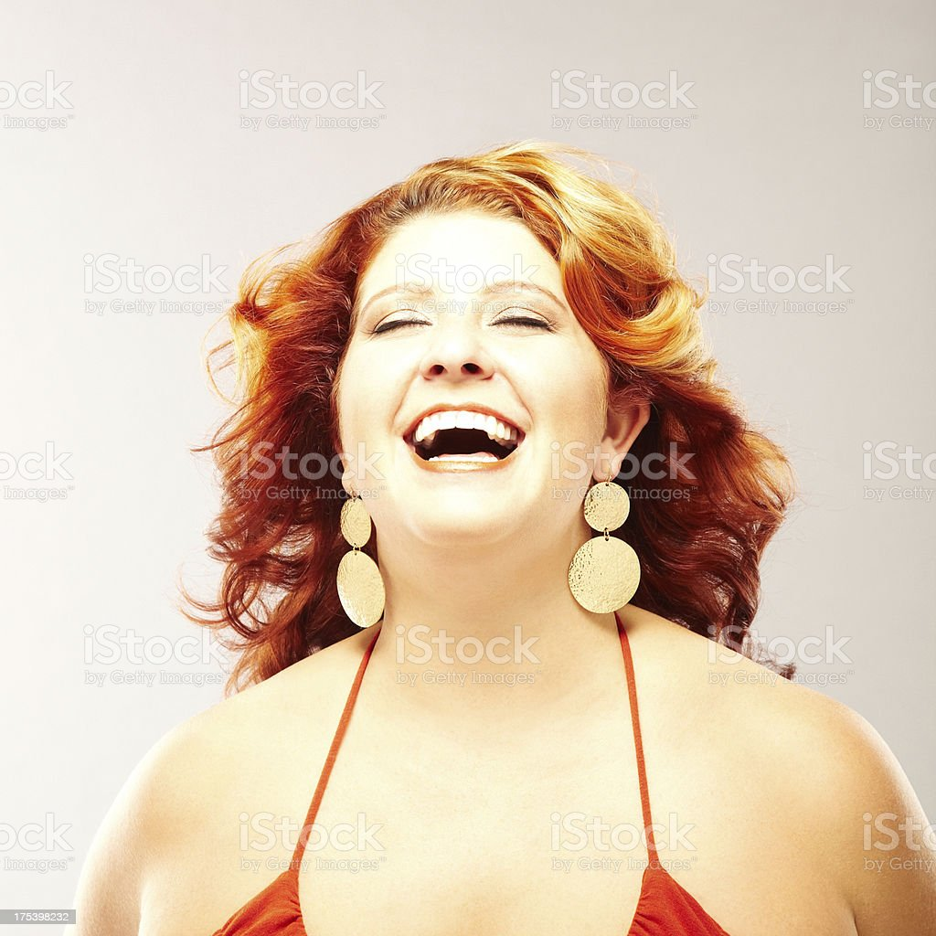 Portrait of a beautiful young woman laughing stock photo
