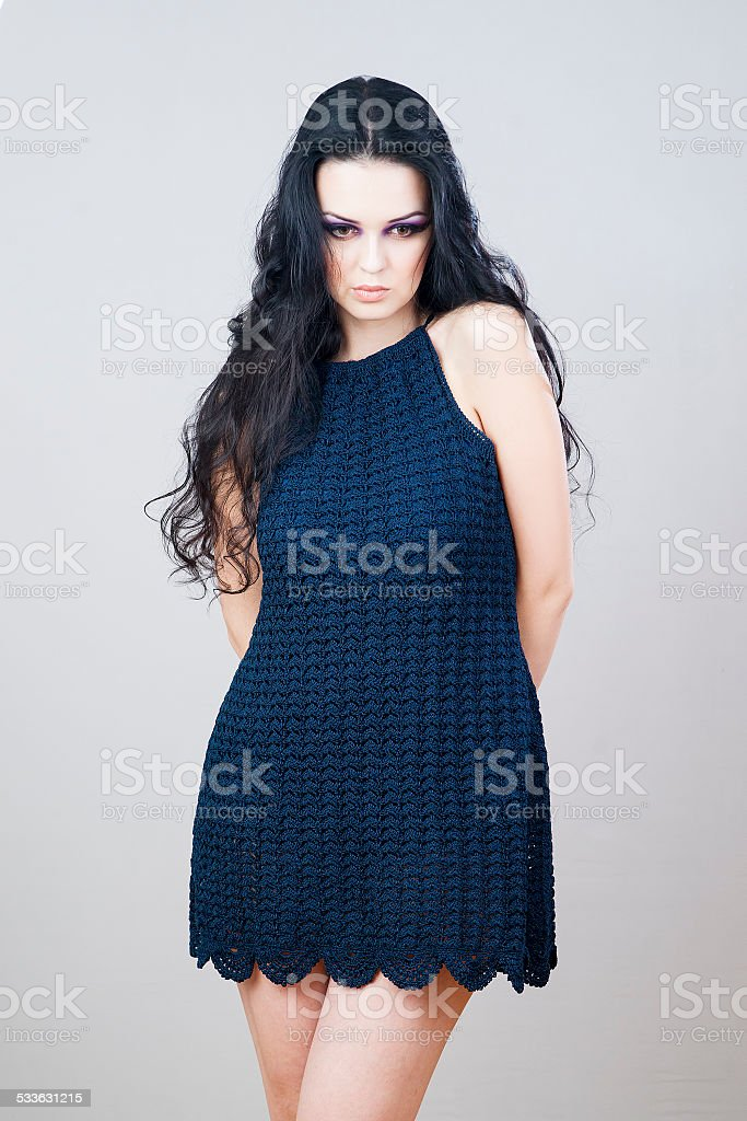 Portrait of a beautiful young woman on a gray background stock photo