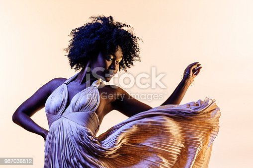 Portrait of a beautiful young black woman, isolated on a studio background