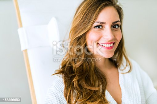 610769340istockphoto Portrait of a beautiful young woman relaxing in a robe 487556650