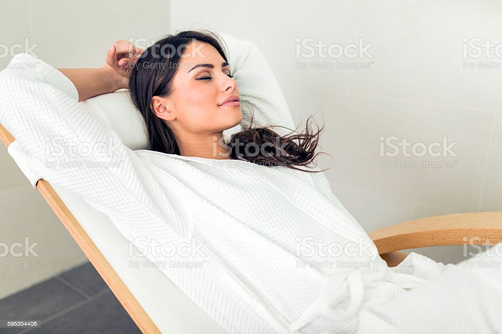 Portrait of a beautiful young woman relaxing in a robe stock photo