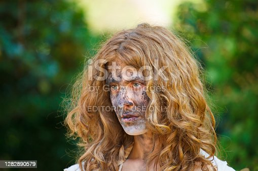Venice, Italy - June, 04: Portrait of a Beautiful young woman with his face covered in the sand during a performance in the Venice Biennale vernissage on June 04, 2011