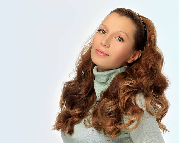 portrait of a beautiful young woman with  long brown hair - woman green eyes red hair stock photos and pictures