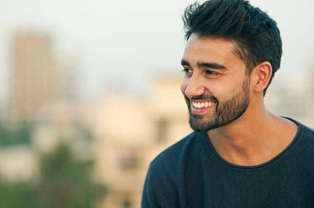 Portrait of a beautifull smiling man. Side view portrait of a beautifull smiling man indian ethnicity charming stock pictures, royalty-free photos & images