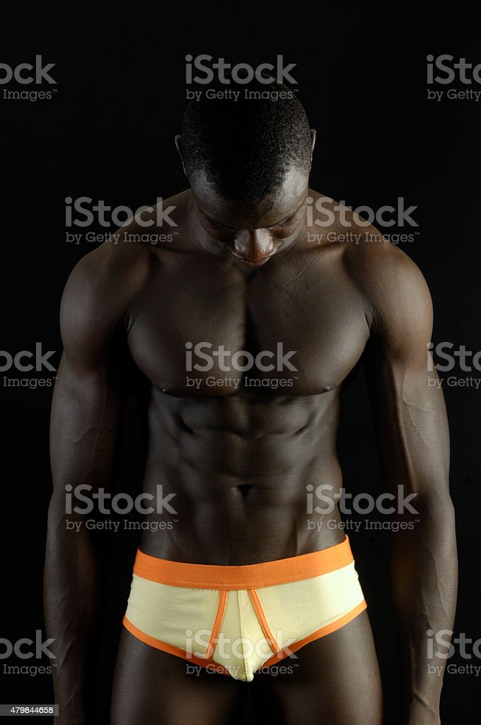 portrait of a black man with a muscular body stock photo