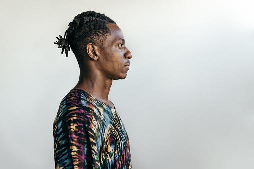 Portrait of a black man with braids