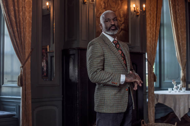 Portrait of a black vintage country gentleman alone in a stately home stock photo