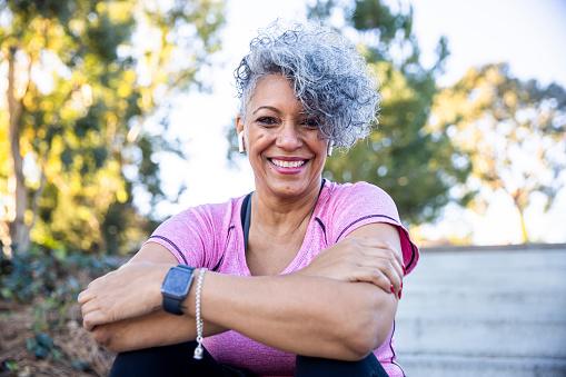A mature black woman enjoying outdoors.