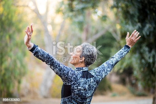 istock Portrait of a Black Woman stretching 898430680