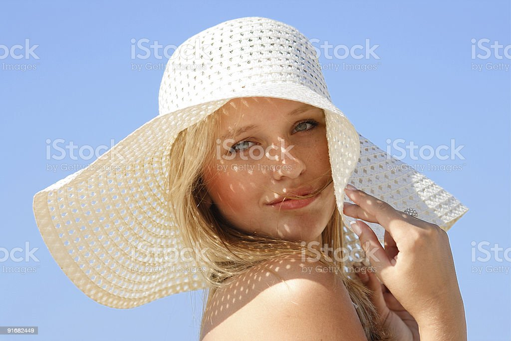Portrait of a blonde woman in a sun hat enjoying summer royalty-free stock photo