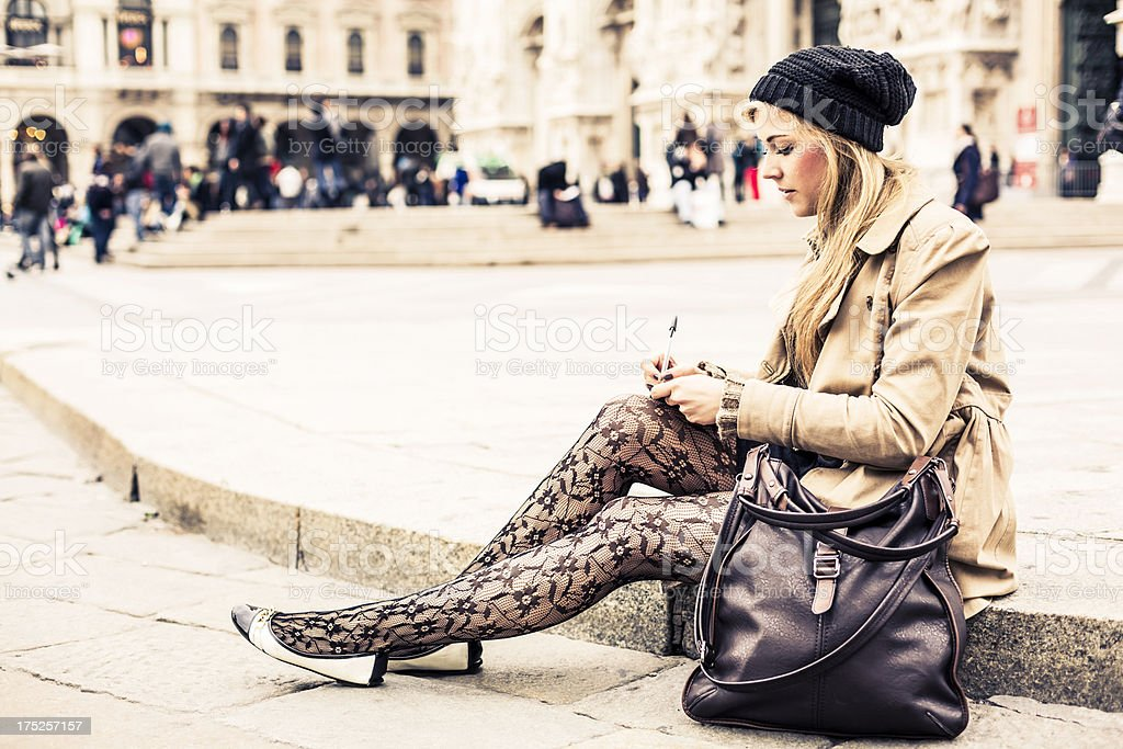 Portrait of a blonde woman writing diary royalty-free stock photo