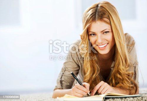 istock Portrait of a blonde woman writing diary 175396696