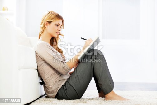 istock Portrait of a blonde woman writing diary. 175438839