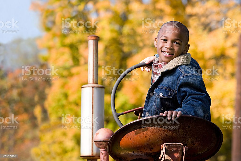 Portrait of a boy on a tractor stock photo