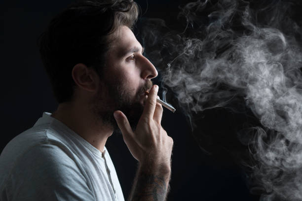 Portrait of a boy who smoke a cigarette - foto stock