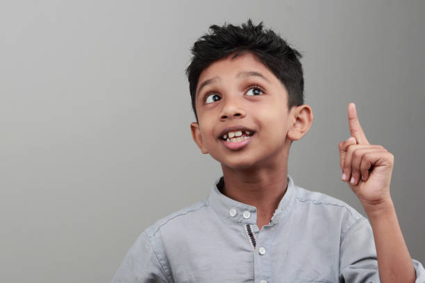 Portrait of a boy with an expression when he gets an idea or solution stock photo
