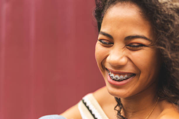 Portrait of a brazilian girl smiling with eyes closed stock photo