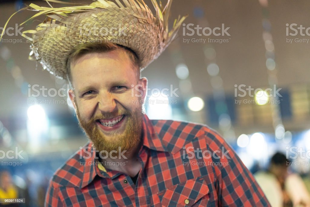 Portrait of a Brazilian man in the Junina Party at night (Festa Junina) - Royalty-free Adult Stock Photo