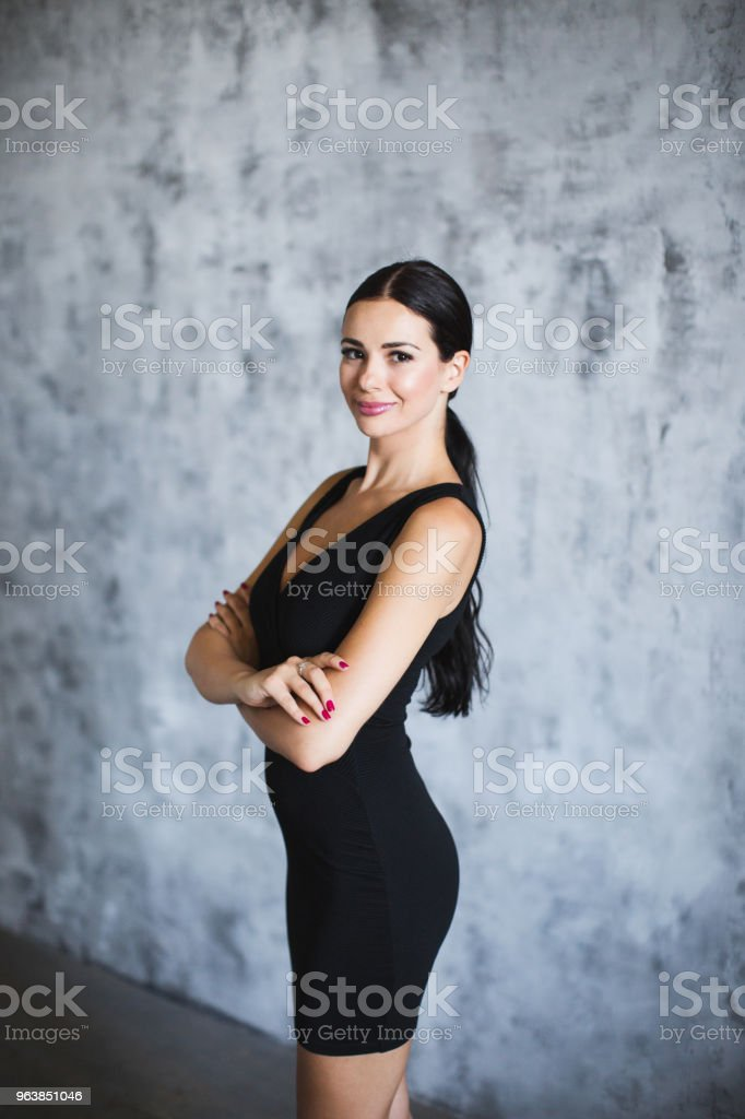 Portrait of a brunette in a black dress. - Royalty-free Adult Stock Photo