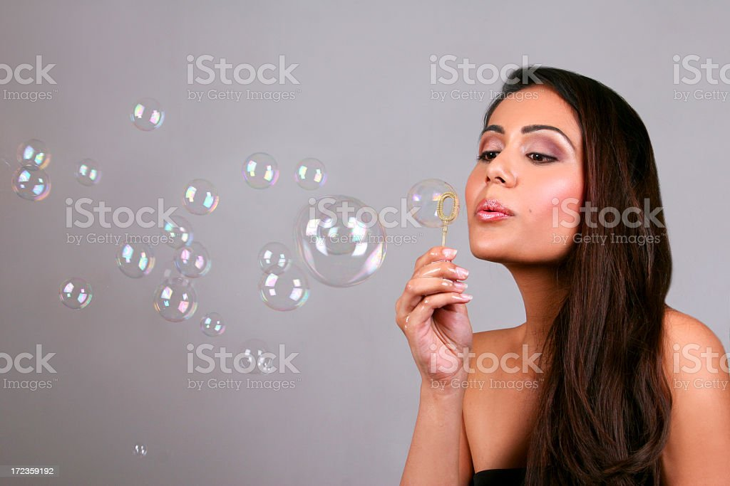 Portrait of a brunette woman blowing bubbles royalty-free stock photo