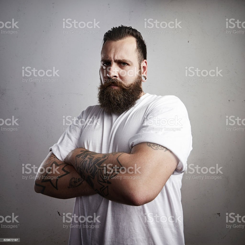 Portrait of a brutal bearded man stock photo