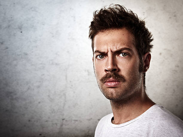 Portrait of a brutal man with a mustache Portrait of a brutal man with a mustache mustache stock pictures, royalty-free photos & images
