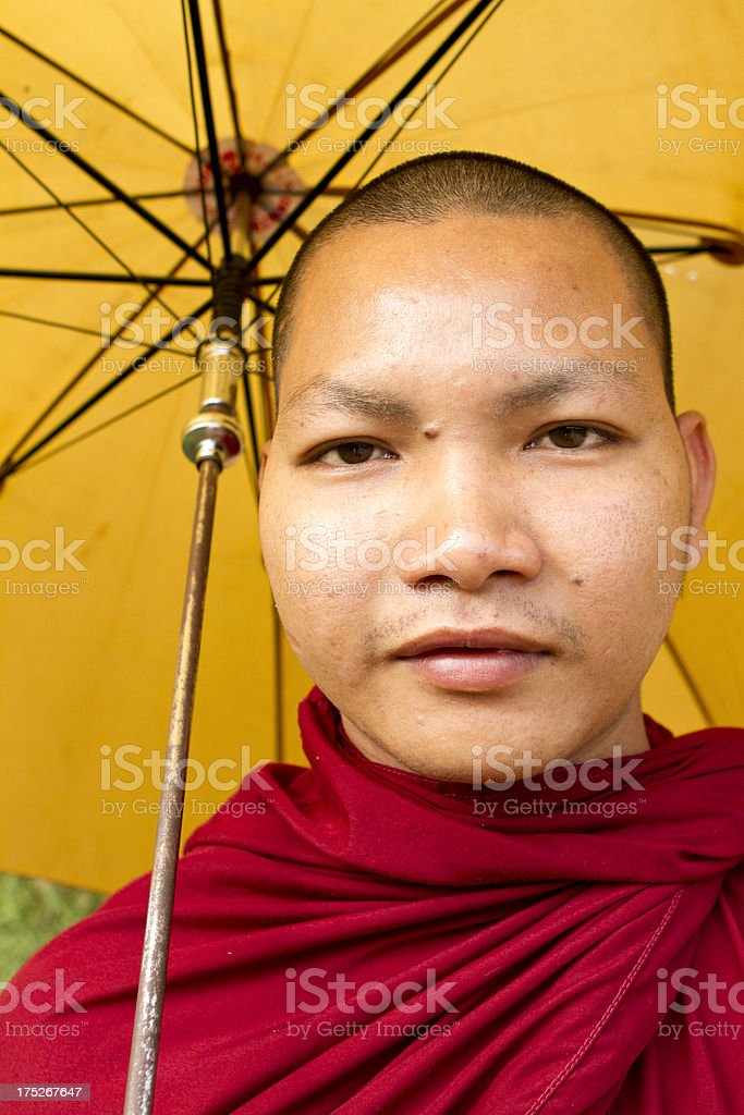 Portrait of a Buddhist monk with umbrella royalty-free stock photo