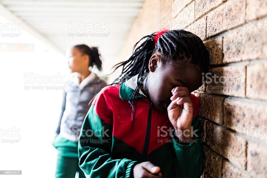 Portrait of a bullied school girl stock photo