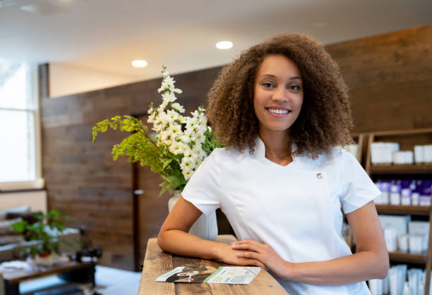 portrait of a business owner working at a spa - massage therapist stock pictures, royalty-free photos & images