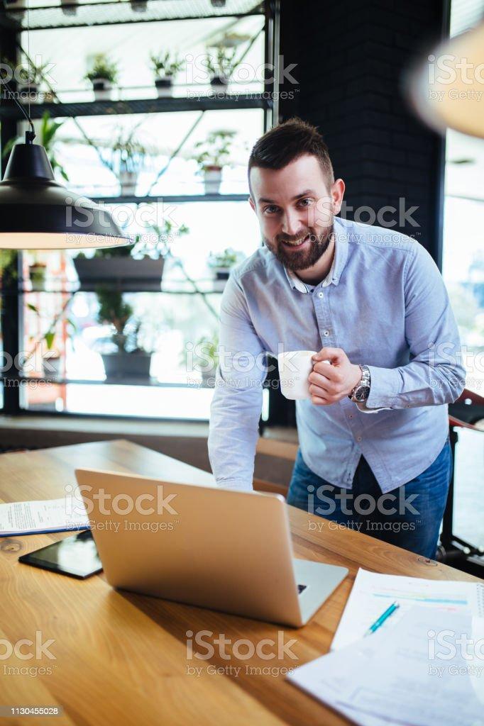 Portrait of a businessman at work place